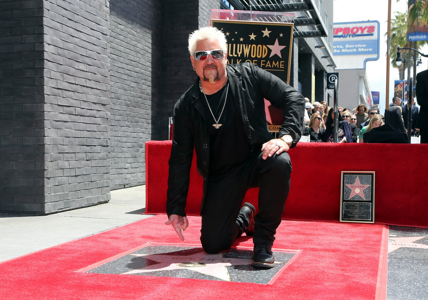 Guy Fieri appears at a ceremony honoring him with a star on the Hollywood Walk of Fame in 2019.