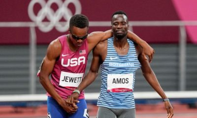 Isaiah Jewett of the United States and Nijel Amos, right of Botswana, shake hands after falling in the men's 800 meter semi-finals at the 2020 Summer Olympics in Tokyo on Sunday, August 1, 2021. (AP Photo / Jae C. Hong) ORG XMIT: OATH669