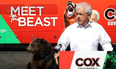 Recall candidate John Cox presented legal documents during the debate