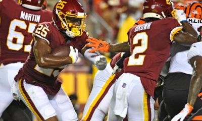 Washington Football team running back Peyton Barber (25) carries the ball against the Cincinnati Bengals in the second quarter at FedEx Field.